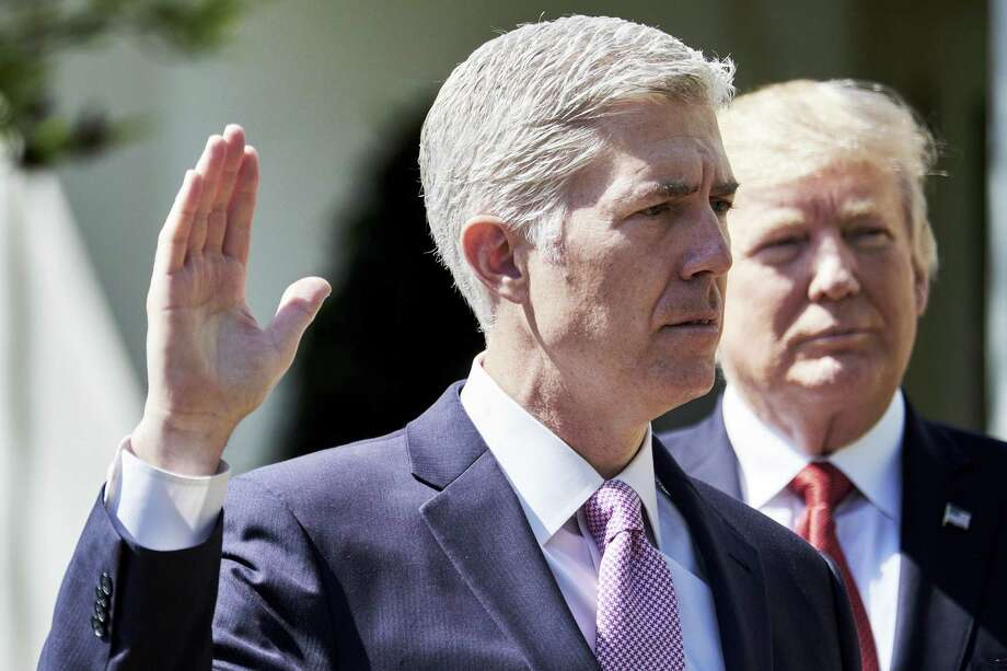 """Judge Neil Gorsuch recites the oath of office as a Supreme Court associate justice as President Donald Trump listens during his swearing-in ceremony   as U.S. Supreme Court associate justice in the Rose Garden  on Monday. A reader says Democratic critics of the GOP use of the """"nuclear option"""" employed   it themselves. Photo: T.J. Kirkpatrick / Bloomberg News / © 2017 Bloomberg Finance LP"""