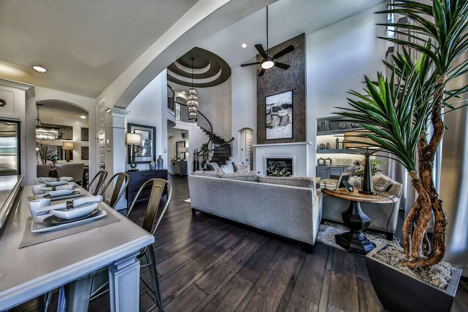 A rotunda foyer with a spiral staircase highlights Westin's Preston III, one of 10 model homes showcased at Elyson, at Grand Parkway and FM 529 in the Katy Independent School District.