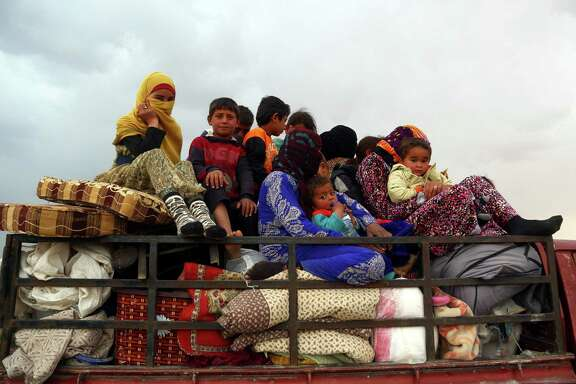 Displaced Syrian arrive in the village of Suwaidiya Saghira, north of Tabqa on March 30, after they fled their homes due to the battles between Syrian Democratic Forces and Islamic State (IS) group jihadists. If President Trump battles ISIS in Syria, this puts less pressure on Bashar Assad, Russia and Iran to reach a political solution for peace.