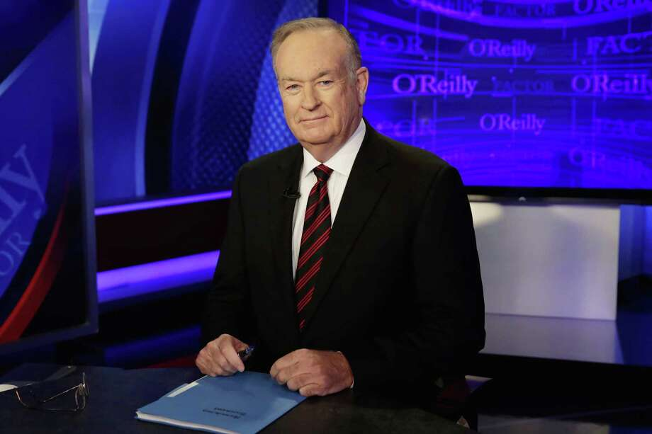 "Bill O'Reilly of ""The O'Reilly Factor"" on the Fox News Channel, poses for photos in the set in New York. Advertisers have been fleeing O'Reilly's show, a reaction to a social media demand for justice given his history on sexual harassment. Photo: Richard Drew /Associated Press / Copyright 2017 The Associated Press. All rights reserved."