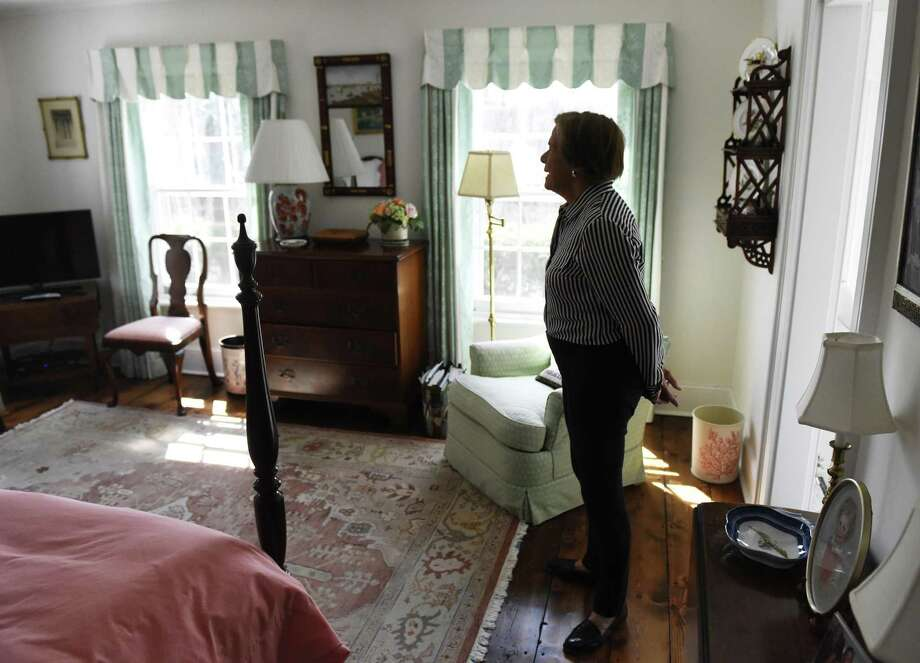 Homeowner Debbie Reynolds shows a bedroom in her 1840s neo-classic home in the backcountry of Greenwich, Conn. Tuesday, April 11, 2017. The Greek-style home on Taconic Road has been renovated and restored to keep to its original look while adding a small expansion done by Douglas VanderHorn Architects. Photo: Tyler Sizemore / Hearst Connecticut Media / Greenwich Time