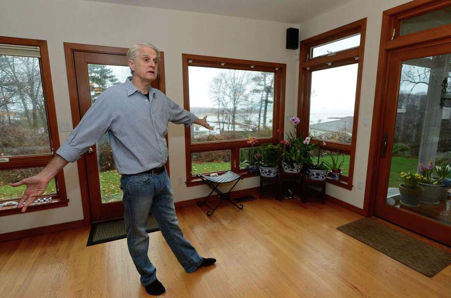 Jud Aley, a Norwalk contractor who specializes in energy efficient home remodeling, kitchen and bathroom renovation, green building, whole house renovations, historic preservation and home repairs, gives a tour of his completely remodeled mid-century modern home Thursday, April 6, 2017, in the historic Village Creek neighborhood of Norwalk, Conn. The house has three different green certifications, LEED for Homes Silver rating, NAHB Gold Level Green Homes Certification and an Energy Star HERS rating of 51 out of a total of 100, meaning the house uses only 51 percent of the energy that a typical home built to code uses.  Village Creek, was established nearly 70 years ago as a cooperative community of modernist houses and is on the National Register of Historic Places. Photo: Erik Trautmann / Hearst Connecticut Media / Norwalk Hour