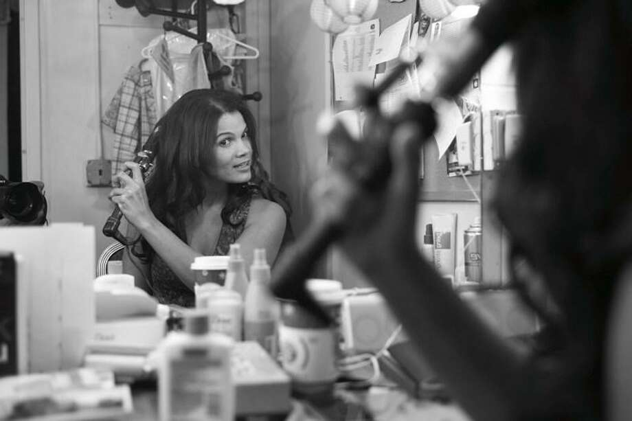 Actor January LaVoy prepares for a stage performance in her dressing room. Photo: Gregory Costanzo /Contributed Photo / Connecticut Post Contributed