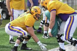 University at Albany left tackle Luke Ritter, left, runs through a drill during football practice on Thursday, April 13, 2017 in Albany, N.Y. (Lori Van Buren / Times Union)