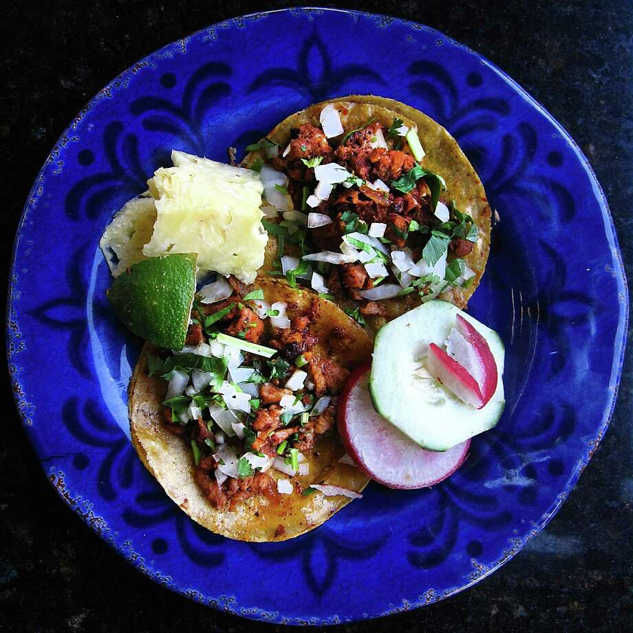 Al pastor tacos with pineapple, lime, radishes, cucumber, cilantro and onions from Taquitos West Ave. on West Avenue. Photo: Mike Sutter /San Antonio Express-News