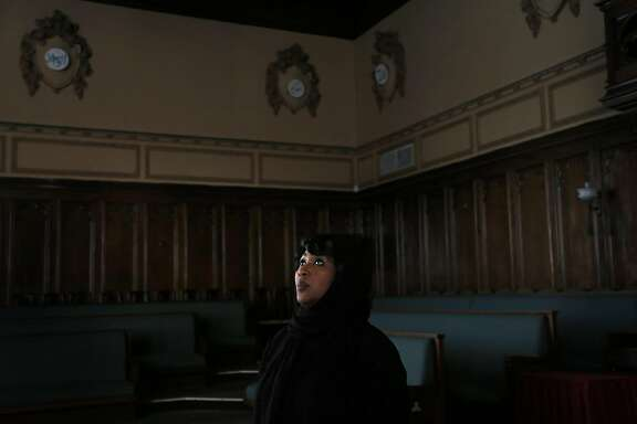 """Rabi'a Keeble talks with friends before the Friday prayers at the Islamic Cultural Center in Oakland, Calif., on Friday, April 7, 2017. The center was originally built as a Masonic Temple. Keeble is the founder of a new women's mosque, the first of its kind in Northern California. She says traditional Islamic patriarchy is a form of slavery and she got tired of asking the men why the separation was necessary. Instead she says, """"I want to talk to the women about why are you putting up with it?"""""""