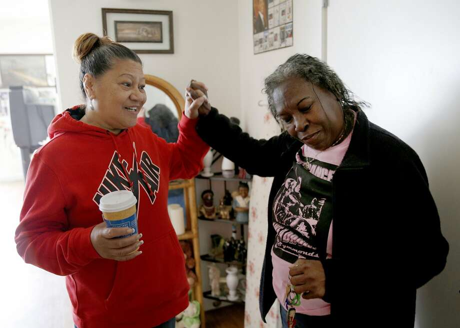 Aitulagi Evans (left) and Betty Brown, who have lived in the neighborhood for 35 years, enjoy Brown's new home at Hunters View. Photo: Santiago Mejia, The Chronicle