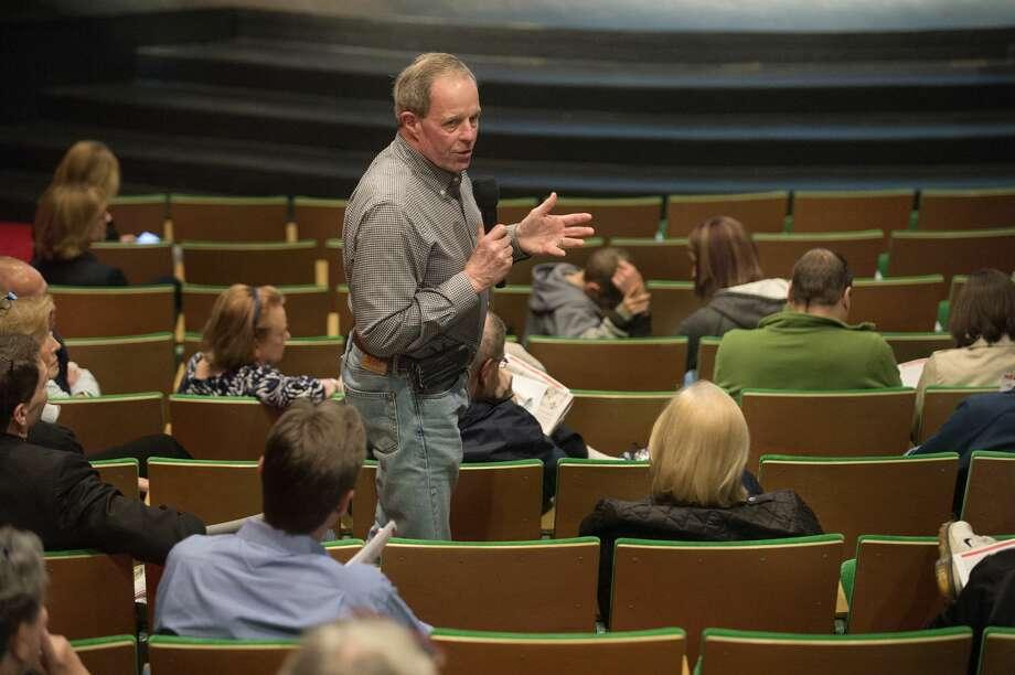 """Chuck Cote of Midland voices his approval of Dow Chemical's proposal to close a portion of South Saginaw Road during a public hearing at the Midland Center for the Arts on Wednesday. Dow Chemical and Dow Corning have facilities on opposite sides of South Saginaw Road and by closing the road between Mark Putnam Road and Salzburg Road the two sites would combined into one. """"This is a step Dow is taking to make things safer,"""" Cote said. Photo: Brittney Lohmiller/Midland Daily News"""
