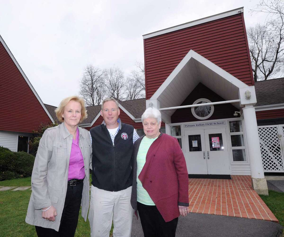 Putnam Indian Field School Headmaster Susan Donaghy, left, with teacher Chase Wierdsma, center, and retired Headmaster Marianne Riess, right, at the school in Greenwich, Conn., Friday, April 7, 2017. Chase's dad, Fred Wierdsma, founded the Putnam School in 1973 and then later merged it with the Indian Field School where he was the headmaster until his retirement in 2001. Wierdsma passed away in January.