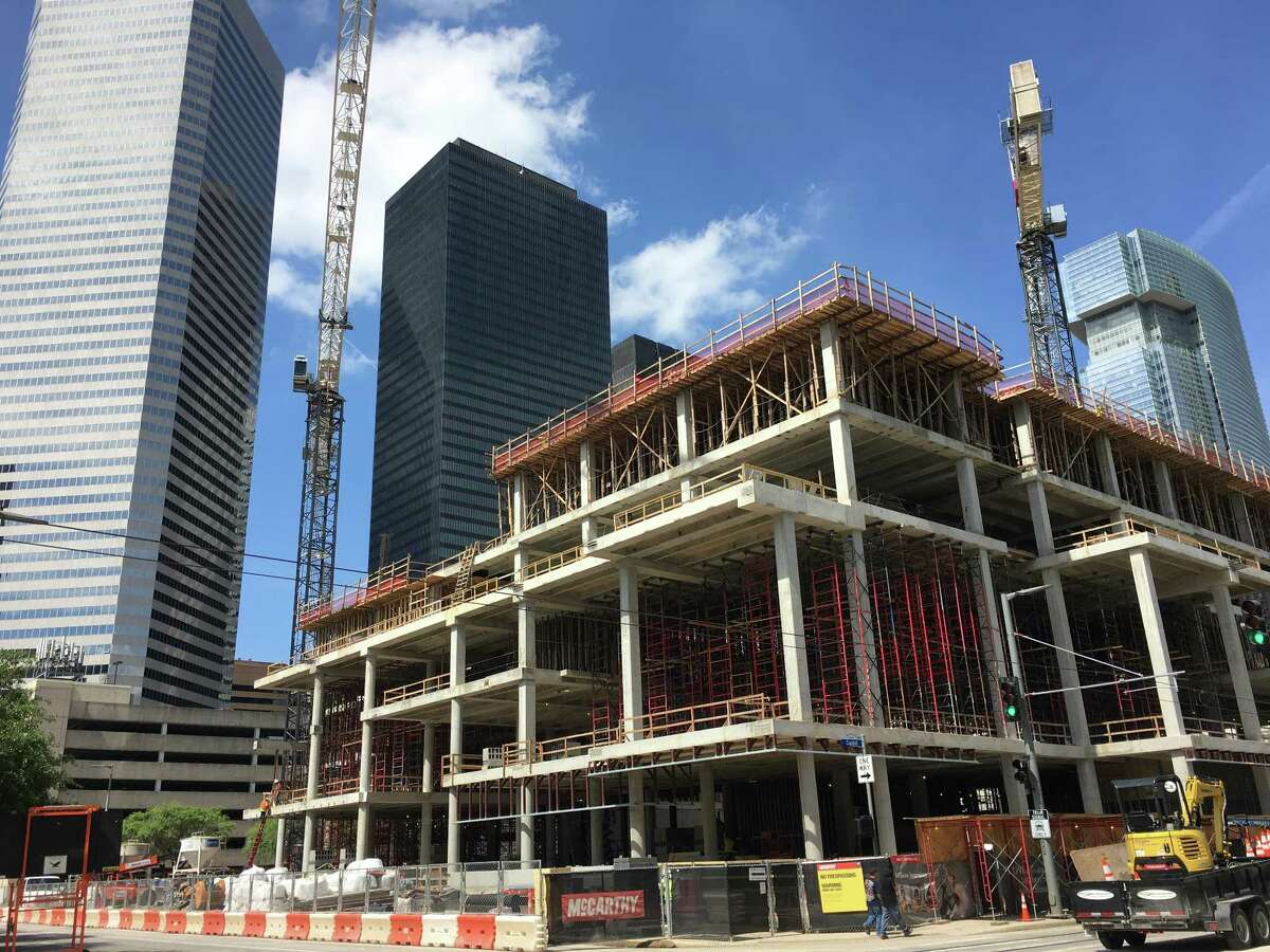 A building goes up in downtown Houston. Thousands of new apartments are helping to transform the city center into a neighborhood that is likely to draw even more restaurants, shops and other businesses.