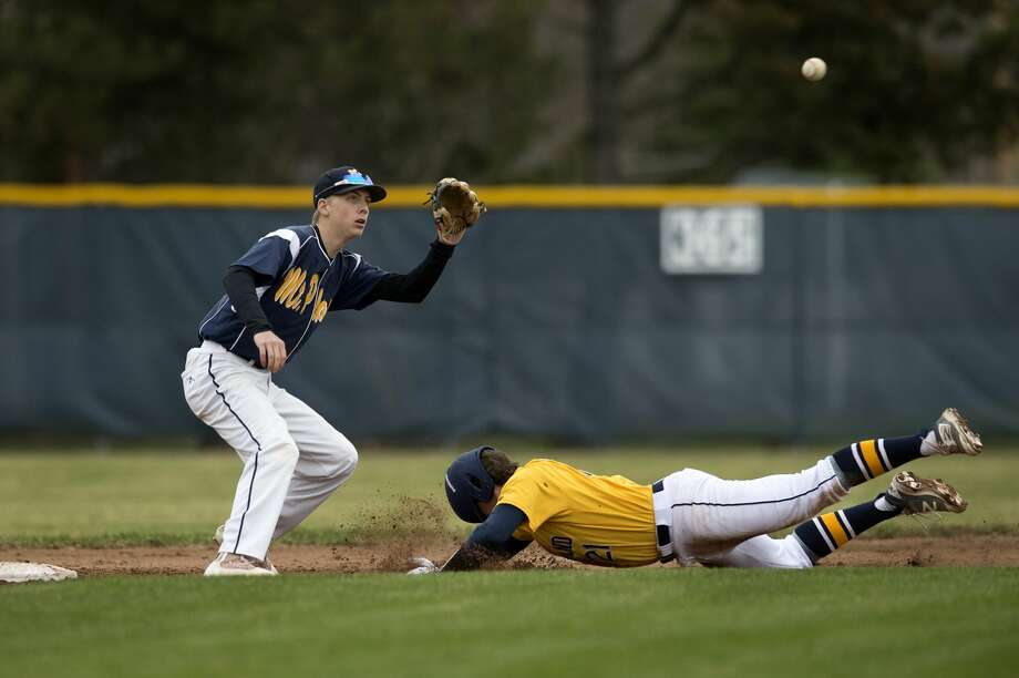 BRITTNEY LOHMILLER | blohmiller@mdn.net Midland High's Martin Money slides to second base before Mount Pleasant's Noah Ingram can tag him out in the sixth inning of the Thursday afternoon game. Mount Pleasant defeated Midland 5-3. Photo: Brittney Lohmiller/Midland Daily News/Brittney Lohmiller