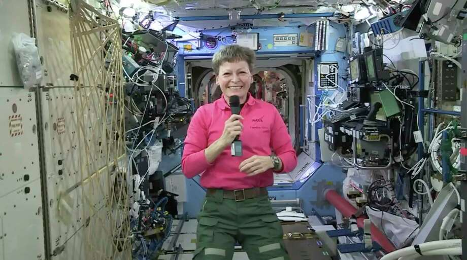 In this Thursday, April 13, 2017 image from video made available by NASA, astronaut Peggy Whitson speaks during an interview aboard the International Space Station. The commander of the ISS says that five months into her current mission, she's still not bored. At 57, she's the oldest woman to fly in space and is on the verge of setting a U.S. record for most accumulated time in space. (NASA via AP) Photo: HOGP / NASA