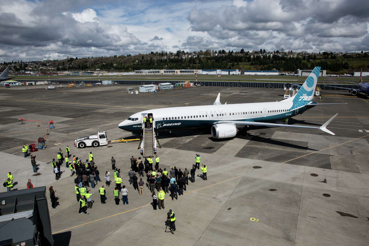 30. Boeing Pictured: A Boeing 737 Max 9 is greeted after the plane's first test flight, at Boeing Field on Thursday, April 13, 2017.