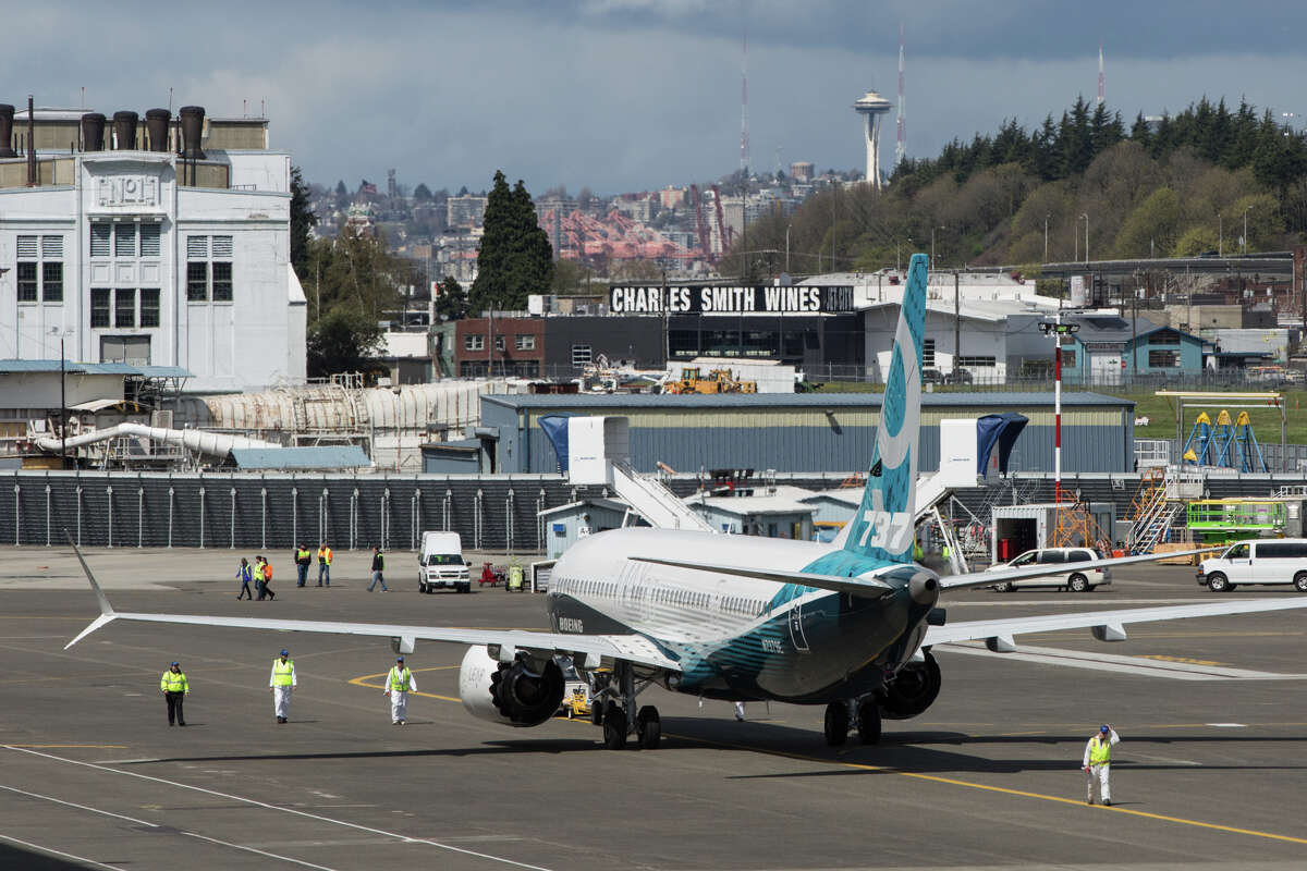 A Boeing 737 Max 9 test plane is taxied to a greeting party following its first test flight at Boeing Field on Thursday, April 13, 2017.