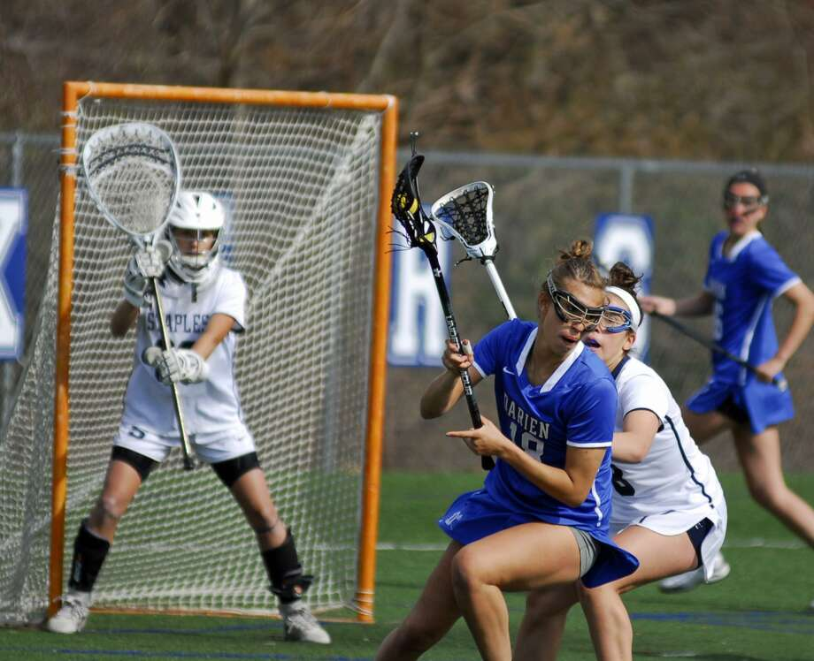 Darien's Christine Fiore looks to make a turn with the ball during a game against Staples Thursday. Photo: Ryan Lacey / Hearst Connecticut Media
