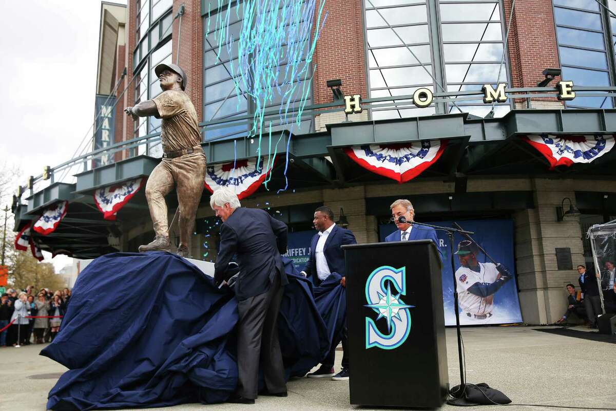 Former Mariner Ken Griffey Jr. and team owner John Stanton unveil a statue of the hall-of-famer outside Safeco Field, April 13, 2017. The statue was made by local artist Lou Cella.