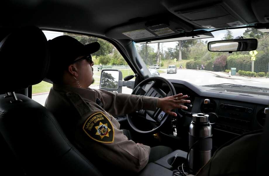 San Francisco park ranger Elmer Jimenez patrols Golden Gate Park. Photo: Michael Macor, The Chronicle