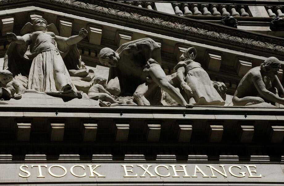 "FILE - This July 15, 2013, file photo, shows the New York Stock Exchange. Global stock markets turned lower and the dollar was volatile Thursday, April 13, 2017, after President Donald Trump withdrew a threat to declare China a currency manipulator and said the U.S. currency was ""getting too strong."" Tensions over North Korea also weighed on investors ahead of a long weekend in many markets. (AP Photo/Mark Lennihan, File) Photo: Mark Lennihan, STF / Copyright 2016 The Associated Press. All rights reserved. This material may not be published, broadcast, rewritten or redistribu"