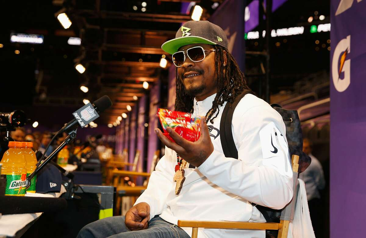 FILE --Marshawn Lynch #24 of the Seattle Seahawks eats Skittles as he addresses the media at Super Bowl XLIX Media Day Fueled by Gatorade inside U.S. Airways Center on January 27, 2015 in Phoenix, Arizona.