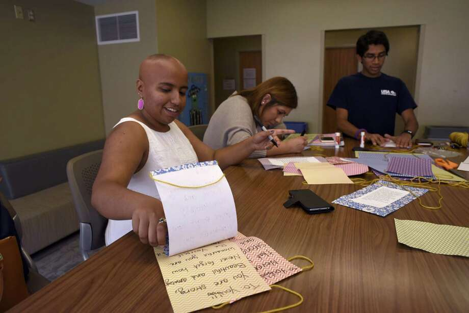 UTSA sophomore Sanah Jivani, left, and friends Itzel Esquivel and Bharath Ram create crafts with positive messages at UTSA on April 6, 2017. Jivani lost all of her hair and was diagnosed with a severe form of alopecia. She founded the Love Your Natural Self Foundation, a 501(c)3 nonprofit, which has a curriculum that has been implemented in more than 40 high school campuses in Texas. Photo: Billy Calzada / San Antonio Express-News / San Antonio Express-News