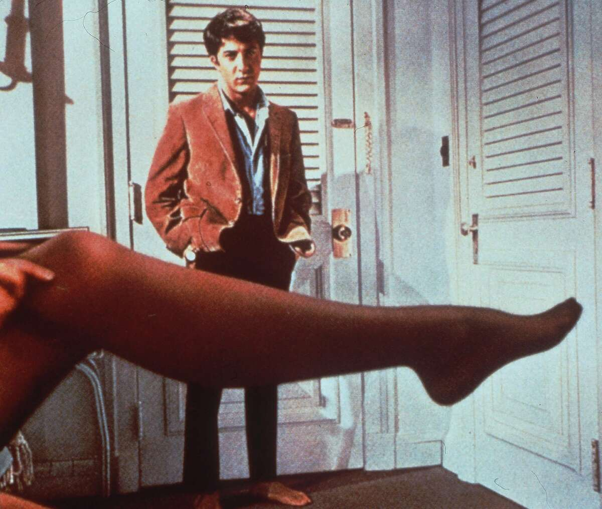 Dustin Hoffman looks at the stockinged leg of body double Linda Gray representing actress Anne Bancroft, his seductress in this scene from the 1967 film