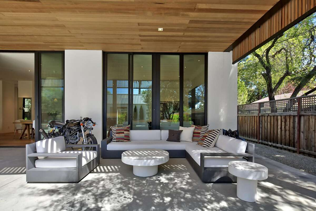 A covered patio stretches beyond the great room.