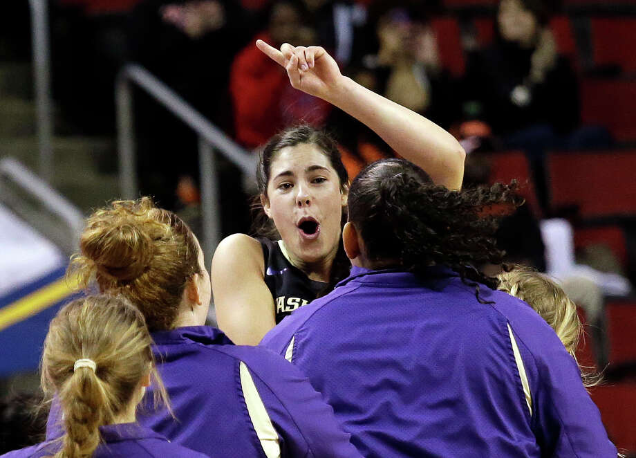 Washington's Kelsey Plum leaps into the arms of teammates at the final horn as the team defeated Stanford in an NCAA college basketball game in the Pac-12 women's tournament, Friday, March 4, 2016, in Seattle. Washington won 73-65. (AP Photo/Elaine Thompson) Photo: Elaine Thompson/AP
