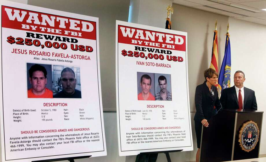 FILE - In this July 9, 2012, file photo, with wanted posters off to the side, Laura E. Duffy, United States Attorney Southern District of California, and FBI Special Agent in Charge, James L. Turgal, Jr., right, announce the indictments on five suspects involved in the death of U.S. Border Patrol agent Brian Terry in Tucson, Ariz. Mexican authorities have arrested the suspected shooter in the 2010 killing of Terry, whose death exposed a bungled gun-tracking operation by the federal government. In a joint statement issued by Mexico's navy and its federal Attorney General's Office on Thursday, April 13, in Mexico City that the suspect who's name wasn't released in Terry's death was arrested near the border between the states of Sinoloa and Chihuahua, a mountainous region note drug activity. (AP Photo/Ross D. Franklin, File) Photo: Ross D. Franklin, STF / Copyright 2017 The Associated Press. All rights reserved.