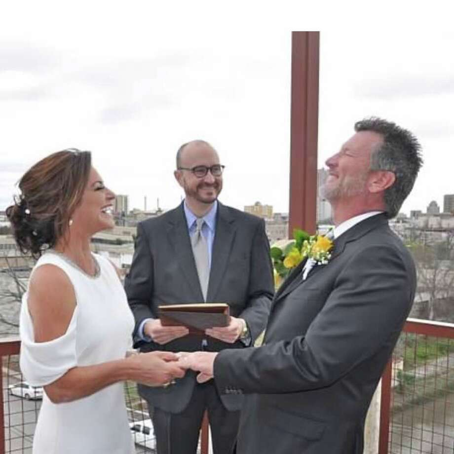 KSAT-TV anchorwoman Ursula Pari and second husband Patrick MacLeod got married recently atop San Antonio's picturesque Paramour bar in what she called 'a pop-up wedding.' Photo: Courtesy Ursula Pari