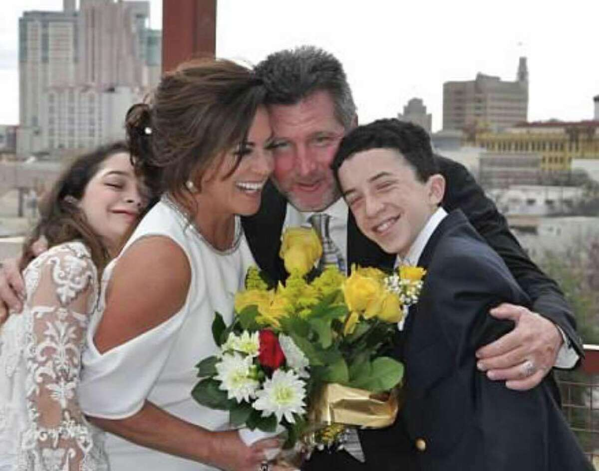 Ursula Pari and her two kids, Georgia and Jackson, share an embrace following her wedding to second husband Patrick MacLeod.
