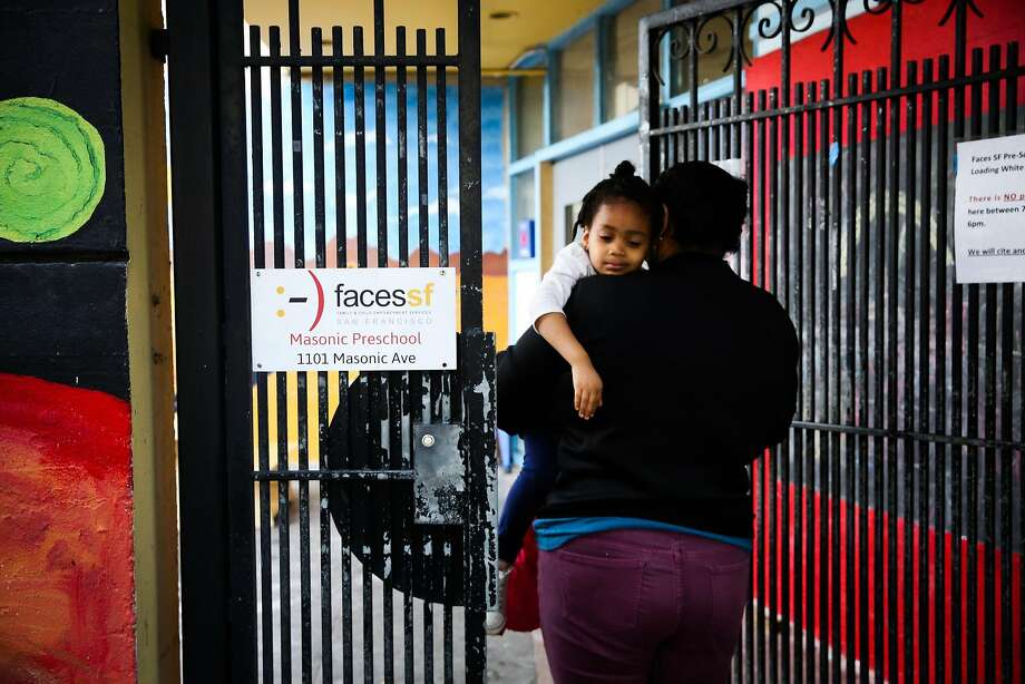 Kailey Norris carries her daughter Khyla Robinson, 3, (left) into her pre-school in the Haight in San Francisco, California, on Thursday, April 13, 2017. Photo: Gabrielle Lurie, The Chronicle