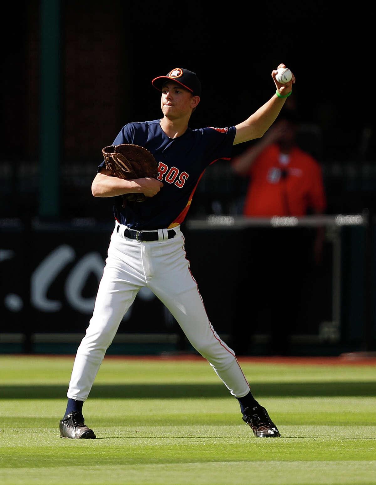 Jackson Ryan, shags balls during Astros batting practice at Minute Maid Park,