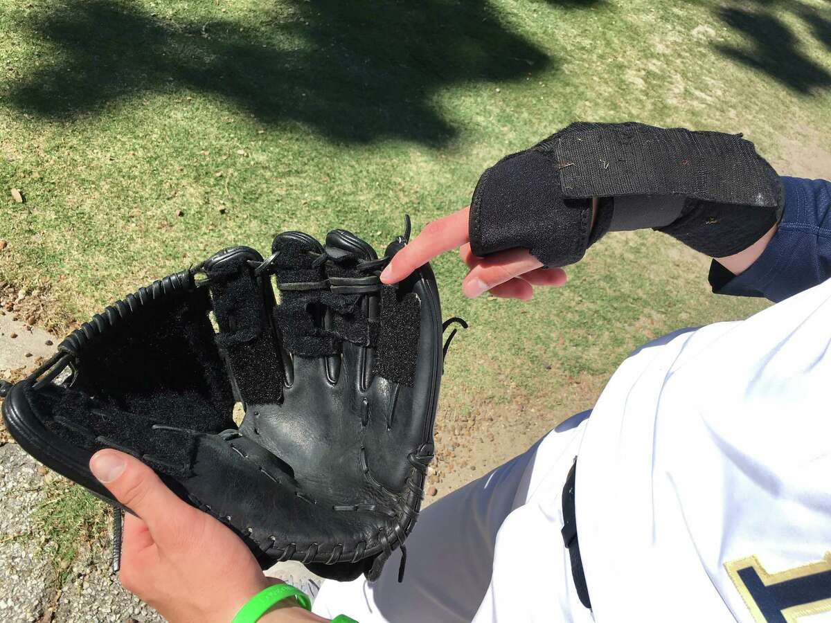 Jackson Ryan's glove has Velcro lining the webbing. More Velcro is wrapped around his wrist to hold the glove.