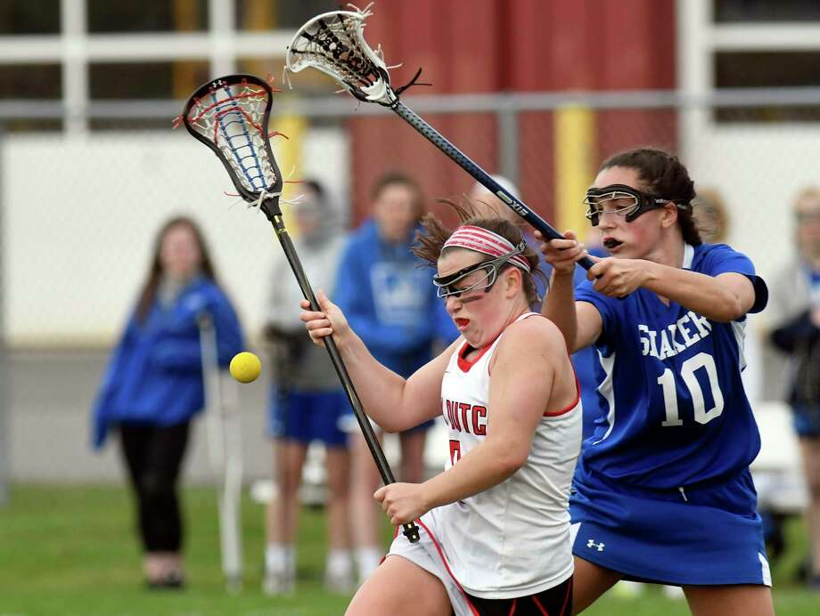 Guilderland's Hayley Kmack ,left, and Shaker's Cait Wood (10) chase a loose ball during a Section II Class A girls lacrosse game in Guilderland, N.Y., Thursday, April 13, 2017. (Hans Pennink / Special to the Times Union) ORG XMIT: HP107 Photo: Hans Pennink / 20040234A