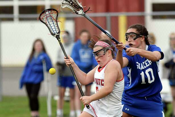 Guilderland's Hayley Kmack ,left, and Shaker's Cait Wood (10) chase a loose ball during a Section II Class A girls lacrosse game in Guilderland, N.Y., Thursday, April 13, 2017. (Hans Pennink / Special to the Times Union) ORG XMIT: HP107