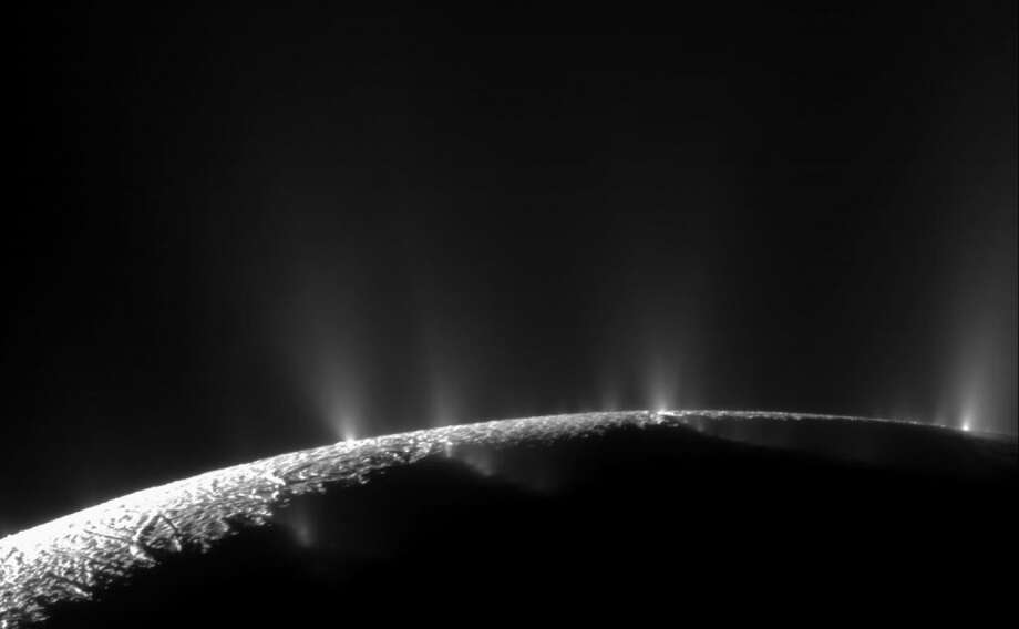 A dramatic plume sprays water ice and vapor from the south polar region of Saturn's moon Enceladus. Cassini's first hint of this plume came during the spacecraft's first close flyby on Feb. 17, 2005. Photo: NASA/JPL/Space Science Institute / Courtesy