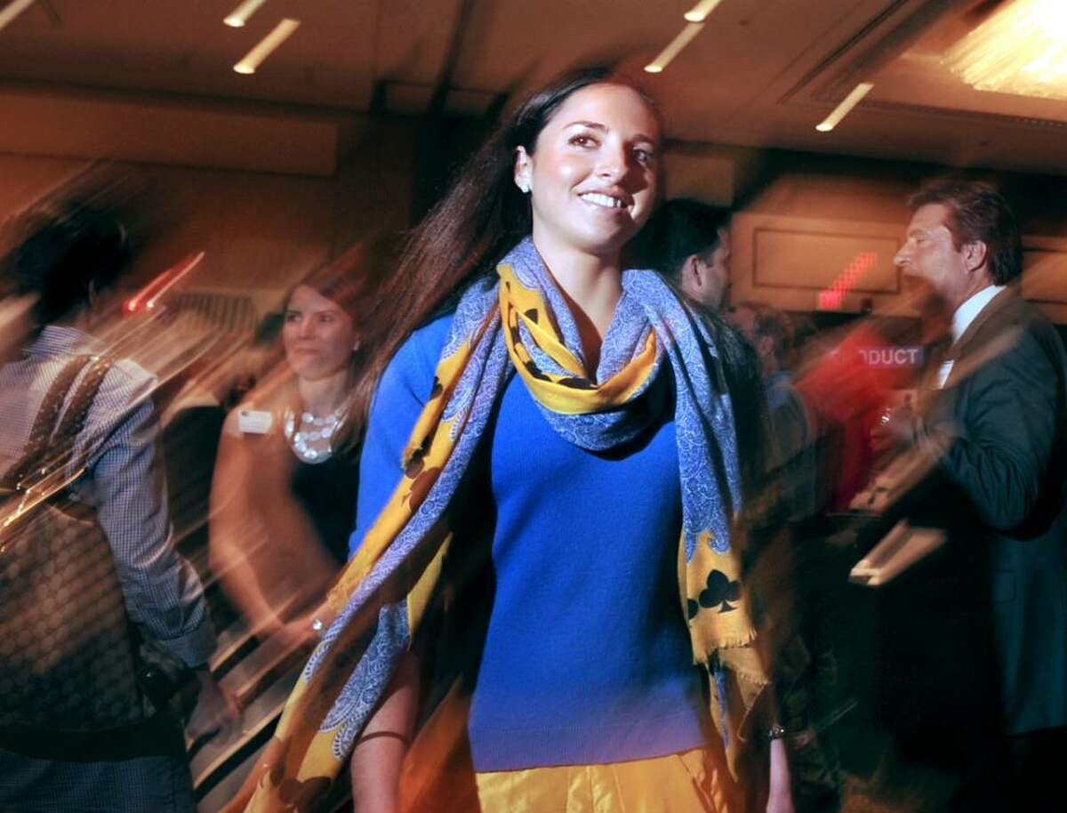 Kristen Carlucci, 22, of Greenwich, models an outfit from local retailer, Cashmere Inc., during the Greenwich Chamber of Commerce Business & Culinary Showcase at the Greenwich Hyatt, Thursday evening, June 3, 2010.