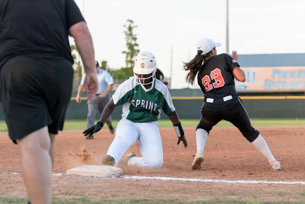 Auyona Moore (17) of the Spring Lions is safe after sliding into third base against the MacArthur Generals in a girls High School Softball game on Thursday, April 13, 2017 at Spring High School in Spring, Texas.