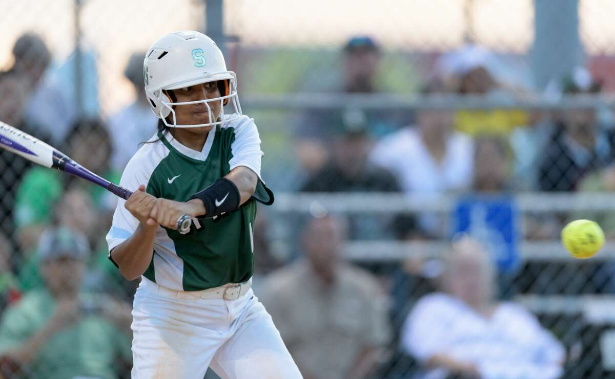 Delilah Bravo (1) of the Spring Lions gets a one base hit against the MacArthur Generals in a girls High School Softball game on Thursday, April 13, 2017 at Spring High School in Spring, Texas.