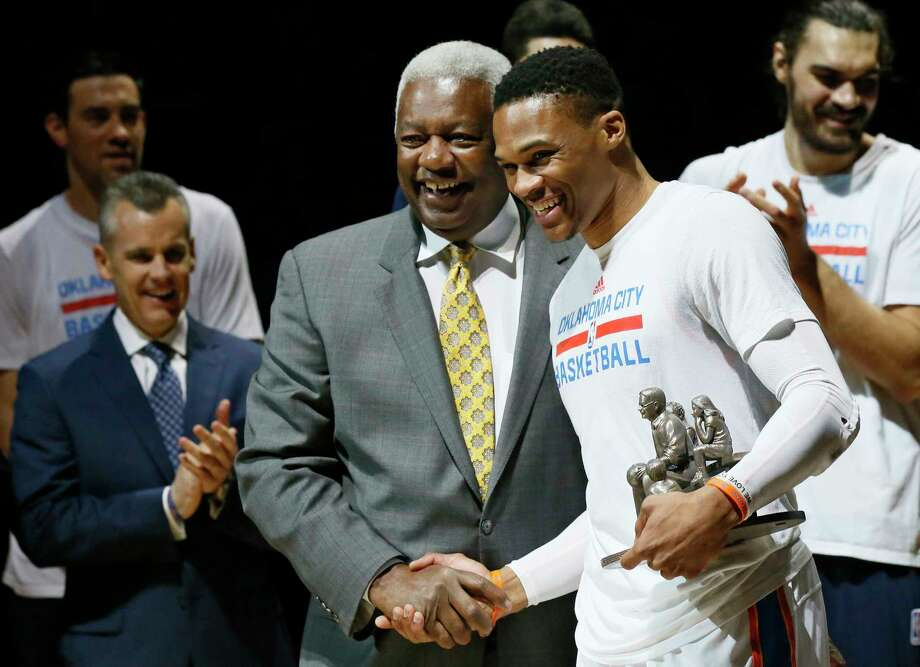Thunder guard Russell Westbrook, right, receives congratulations Wednesday from Oscar Robertson, the triple-double record holder before Westbrook's banner season netted 42 of them. Photo: Sue Ogrocki, STF / AP2017