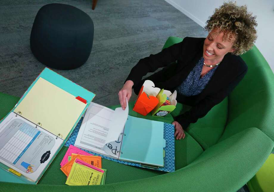 Mary Beth Nerone, a former middle-school teacher from Rochester, N.Y., now sells her old teaching material online. Photo: Bebeto Matthews, STF / Copyright 2017 The Associated Press. All rights reserved.