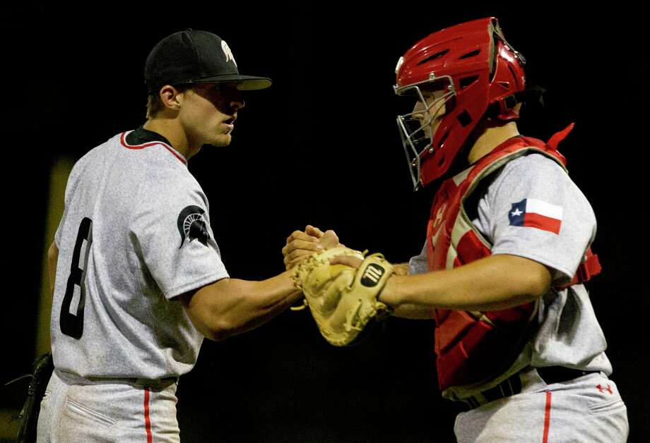 Porter reliever Drew Large celebrates with catcher Brent Sipe (23) after striking out Baret Ortga #10 of Splendora for the final out of a District 21-5A high school baseball game, Thursday, April 13, 2017, in Splendora. Photo: Jason Fochtman, Staff Photographer / © 2017 Houston Chronicle