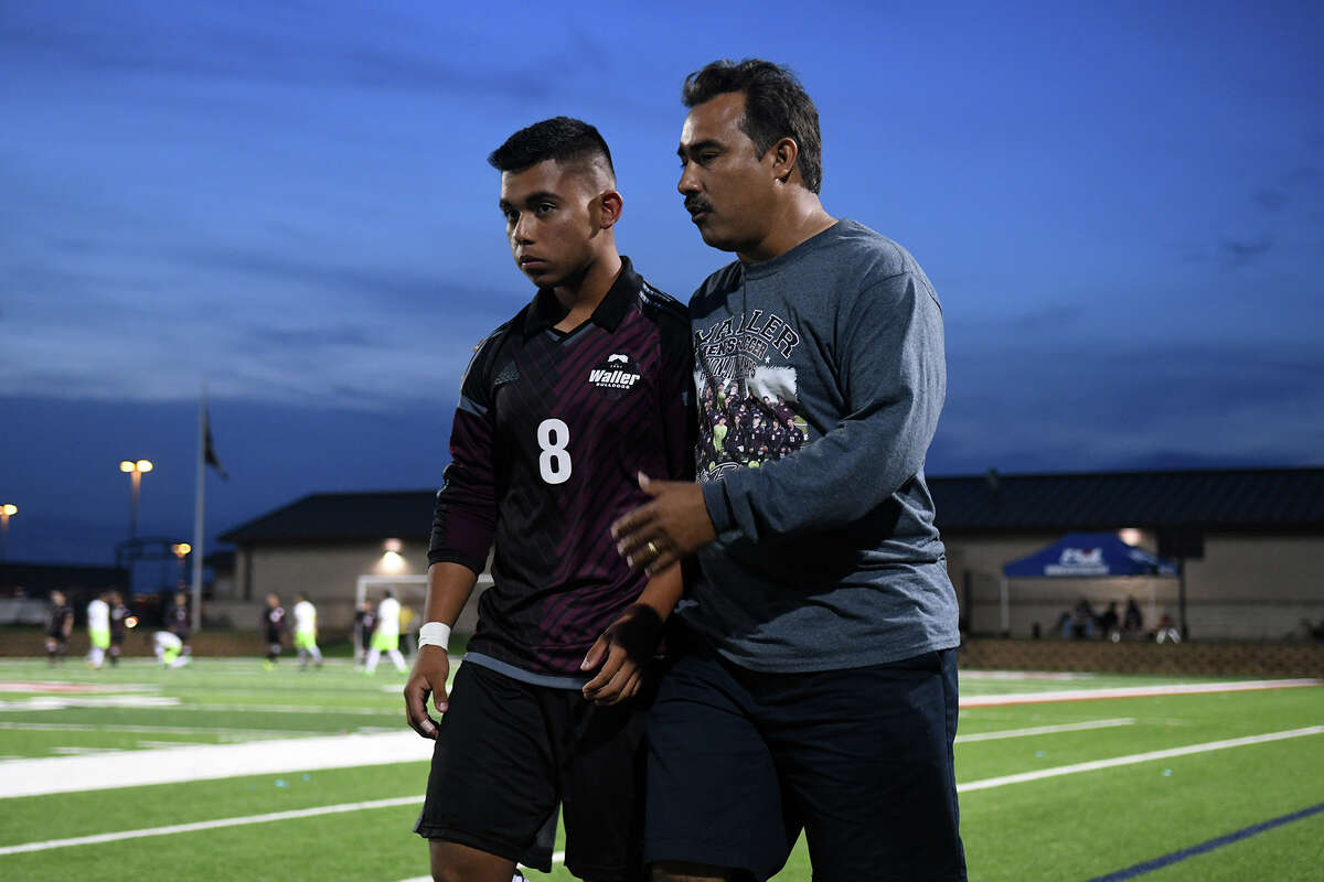 Waller junior midfielder Andres Ocampo (8) gets some one-on-one instructions from Bulldogs Head Coach Juan Saldana during the first half of their Class 5A Boys Soccer state semifinal matchup with Brownsville Lopez at Birkelbach Field in Georgetown on Thursday, April 13, 2017. (Photo by Jerry Baker/Freelance)
