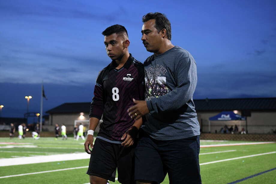 Waller junior midfielder Andres Ocampo (8) gets some one-on-one instructions from Bulldogs Head Coach Juan Saldana during the first half of their Class 5A Boys Soccer state semifinal matchup with Brownsville Lopez at Birkelbach Field in Georgetown on Thursday, April 13, 2017. (Photo by Jerry Baker/Freelance) Photo: Jerry Baker/For The Chronicle