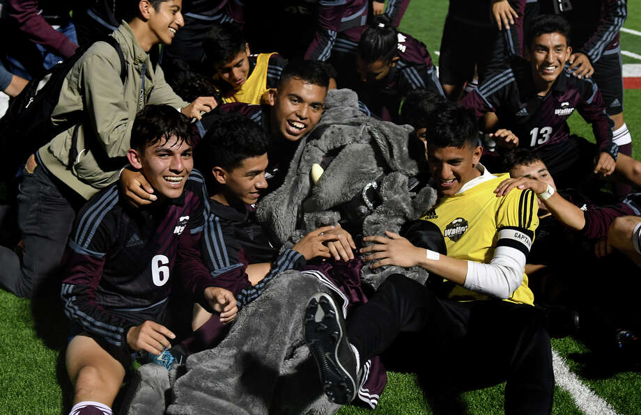 "Waller High School mascot Vanessa Amaya (""Wilma"" the Lady Bulldog) shares in the celebration after the Bulldogs defeated Brownsville Lopez 4-0 in their Class 5A Boys Soccer state semifinal matchup at Birkelbach Field in Georgetown on Thursday, April 13, 2017. (Photo by Jerry Baker/Freelance) Photo: Jerry Baker/For The Chronicle"