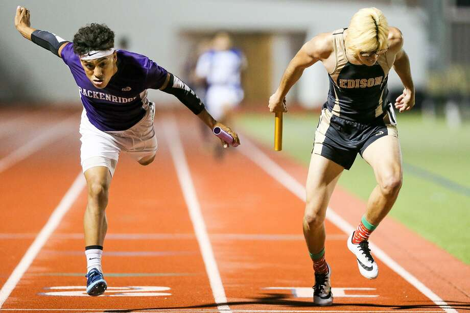 Brackenrridge's Xavier Alcaraz (left) lunges to beat Edison's Jesus Martinez at the finish line of the boys 1600 meter relay and secure the team championship at Alamo Stadium on Thursday. Photo: Marvin Pfeiffer / San Antonio Express-News / Express-News 2017