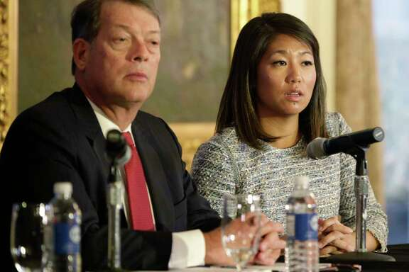 Crystal Dao Pepper, a daughter of Dr. David Dao, is accompanied by attorney Stephen Golan during a news conference Thursday in Chicago.