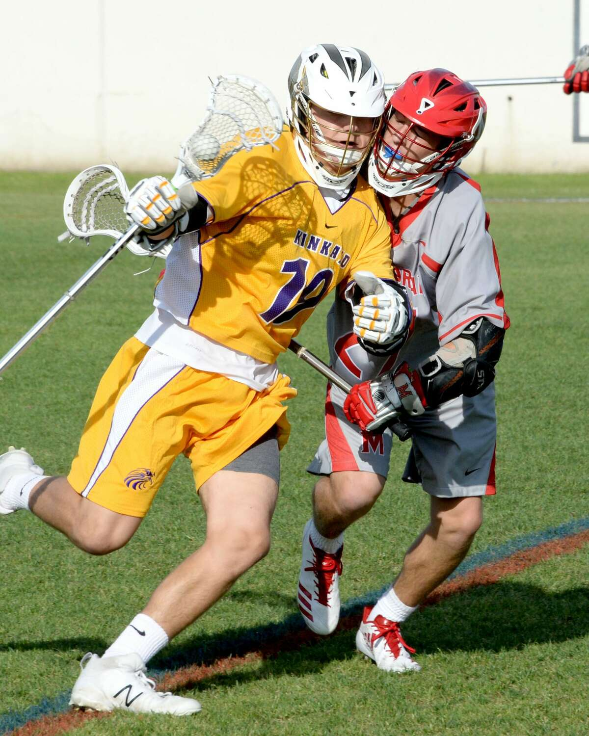 Jacob Magelssen (19) of Kinkaid advances the ball in the first quarter of a varsity boys lacrosse match between the Memorial Mustangs and the Kinkaid Falcons on Thursday April 13, 2017 at Grob Stadium, Houston, TX.