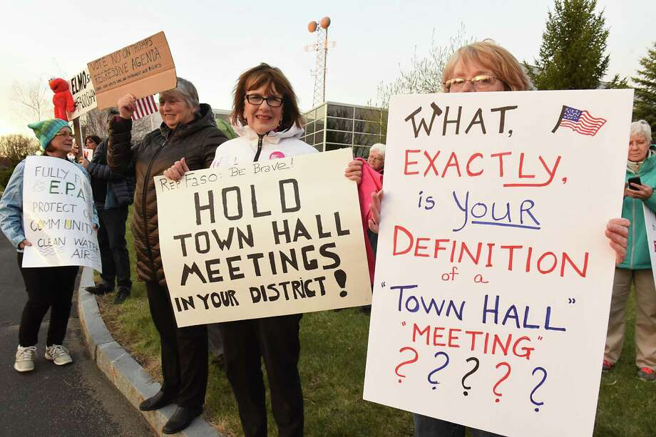 Protestors are seen outside the WMHT studio before Rep. John Faso, R-Kinderhook, took part in a televised town hall event moderated by Matt Ryan of ONew York NowO and the Times UnionOs Casey Seiler on Thursday, April 13, 2017 in Troy, N.Y. (Lori Van Buren / Times Union) Photo: Lori Van Buren / 20040036A