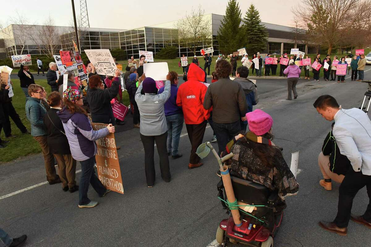 Protestors are seen outside the WMHT studio before Rep. John Faso, R-Kinderhook, took part in a televised town hall event moderated by Matt Ryan of ONew York NowO and the Times UnionOs Casey Seiler on Thursday, April 13, 2017 in Troy, N.Y. (Lori Van Buren / Times Union)